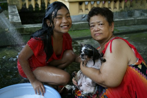 "Xianelle and Mamita giving ""Angel"" a bath"