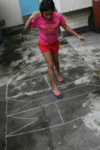 "Playing Philippines' traditional game of ""Piko"""